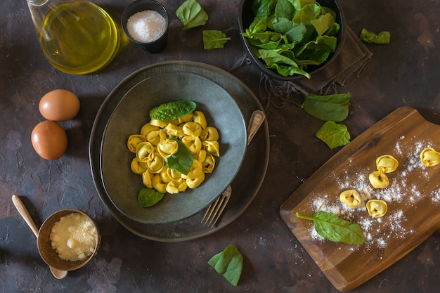 Plate of tortellinis with ricotta and spinach.