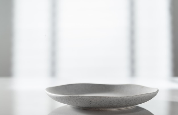 Plate on white kitchen table
