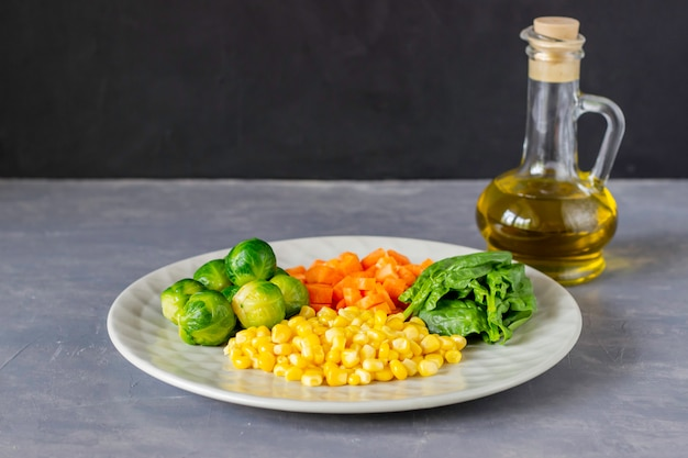 Plate with cabbage, carrots, corn and spinach