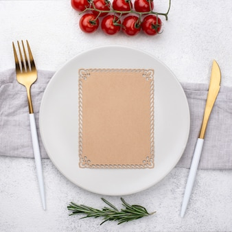 Plate with cutlery and tomatoes