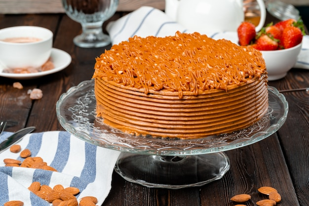 Plate with delicious caramel cake close up
