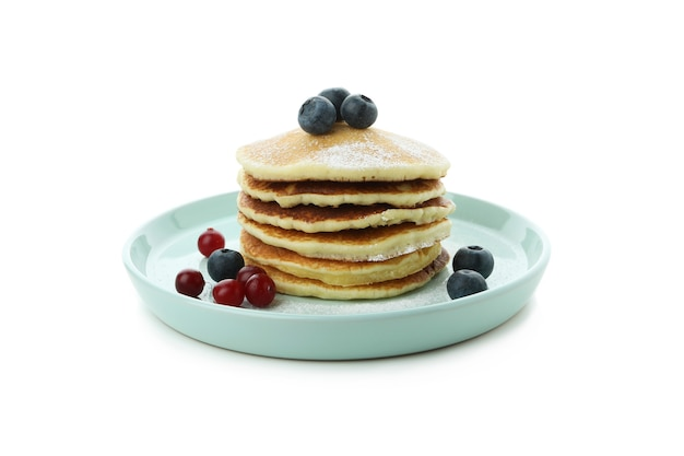 Plate with delicious pancakes isolated on white background