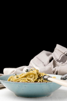 Plate with delicious spaghetti on table