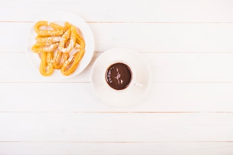 Plate with dessert and chocolate sauce on table