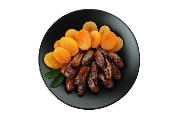 Plate with dried dates and apricots isolated on white surface
