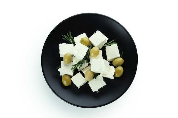 Plate with feta cheese, olives and rosemary isolated on white surface