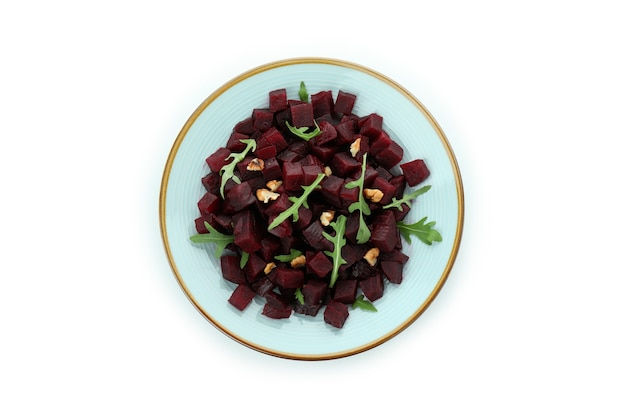 Plate with fresh beet salad isolated on white background