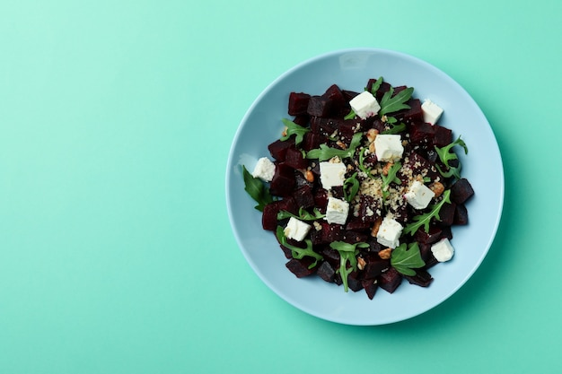 Plate with fresh beet salad on mint
