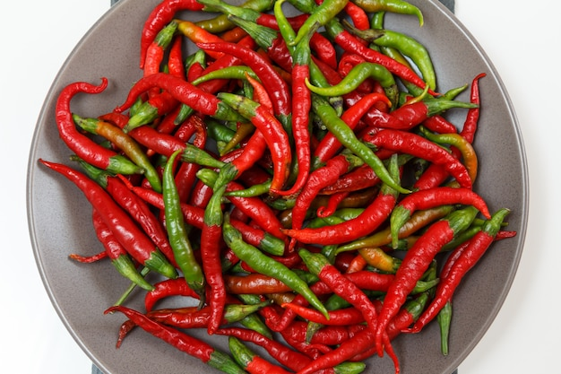 Plate with fresh and dry hot peppers