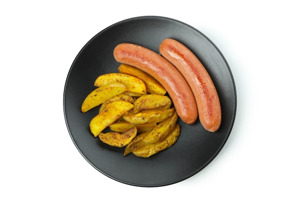 Plate with fried potato and sausages isolated on white background