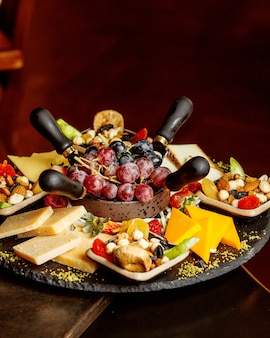 Plate with fruits cheese and nuts
