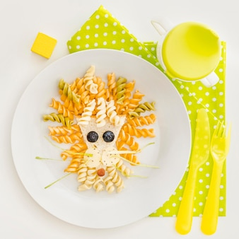 Plate with fusilli in decorative shape for babt