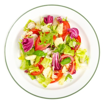 Plate with lettuce tomatoes olive oil