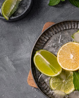 Plate with lime and lemon slices top view