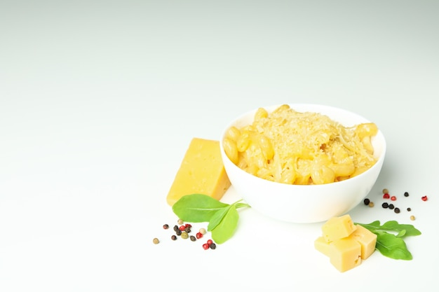 Plate with macaroni and cheese on white background