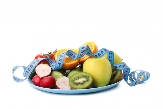 Plate with measuring tape and vegetarian food isolated