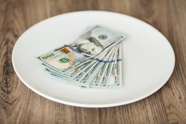 Plate with money,