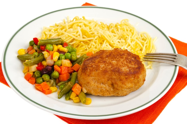 Plate with noodles, vegetables and breaded cutlet