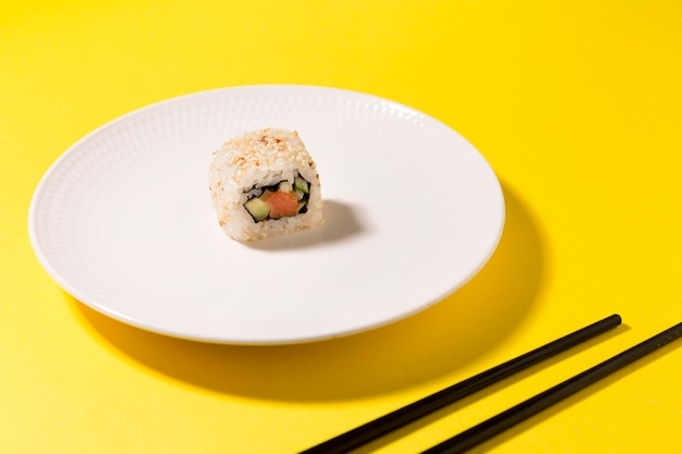 Plate with one sushi roll