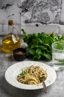 Plate with pasta and herbs