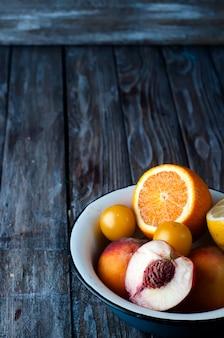 Plate with peach, lemon and orange
