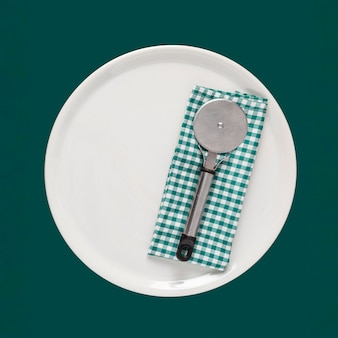 Plate with pizza cutter