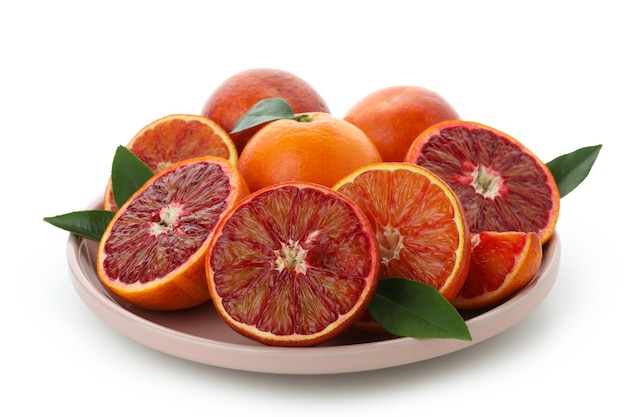 Plate with red oranges isolated on white