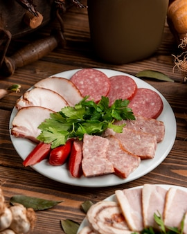 Plate with sliced ham and sausages 1