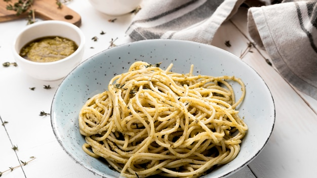 Plate with spaghetti on table