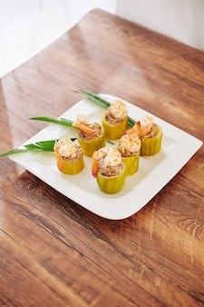 Тарелка с фаршированными кабачками