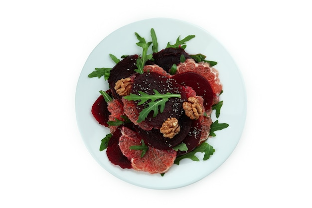 Plate with tasty beet salad isolated on white background