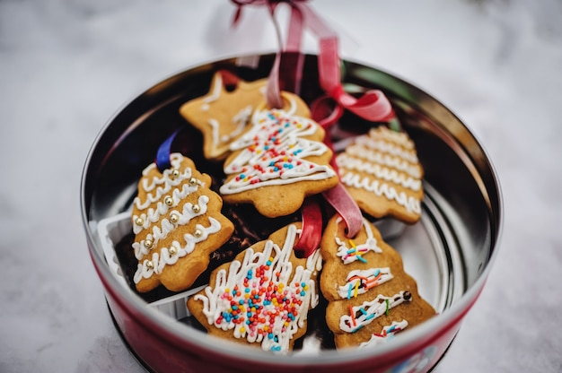 Plate with tasty christmas cookies, gingerbread on snowy with copy space for text. holiday, celebration and cooking concept. happy new year and christmas. postcard.