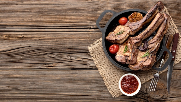 Plate with tasty meat and sauce with copy-space