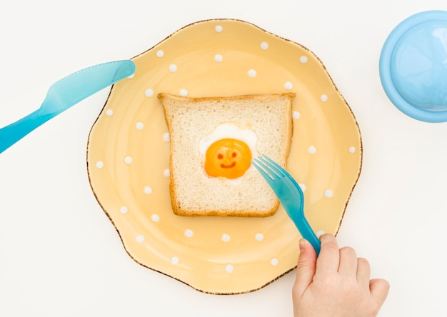 Plate with toast for baby on desk