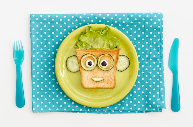 Plate with toast face shape with apple