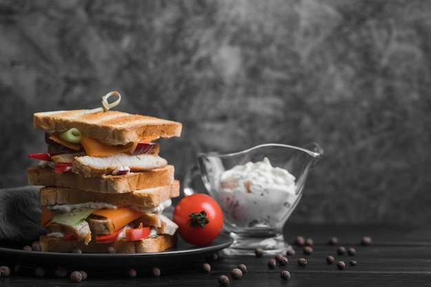 Plate with toast sandwiches on table