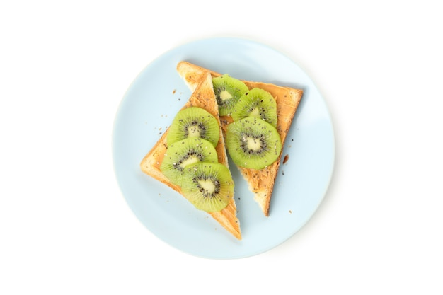 Plate with toasts with kiwi isolated on white background