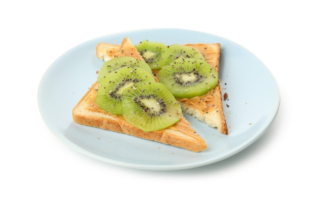 Plate with toasts with kiwi isolated on white Premium Photo