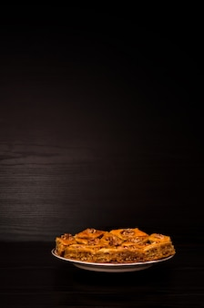 Plate with turkish baklava honey on a black background