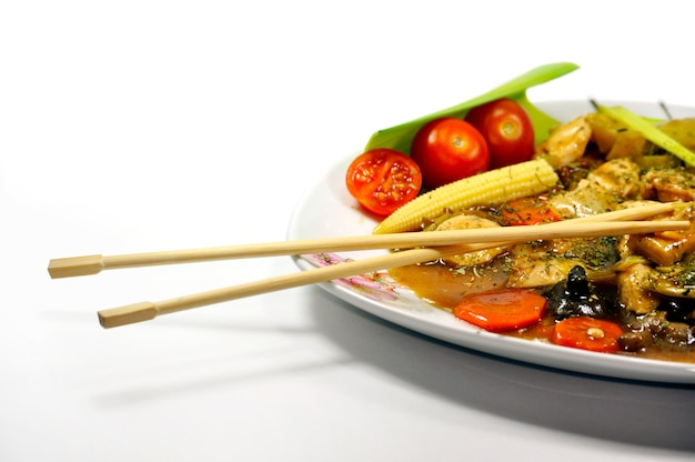 Plate with vegetables and chopsticks
