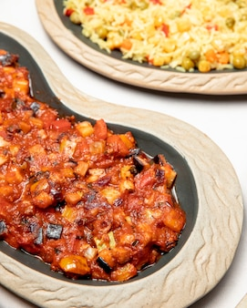 Plates of vegetable stew and pilaf