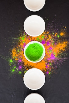 Plates with bright powders on table