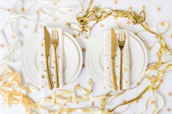 Plates with fork and knife on table