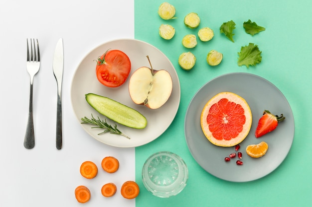 Plates with healthy food and cutlery