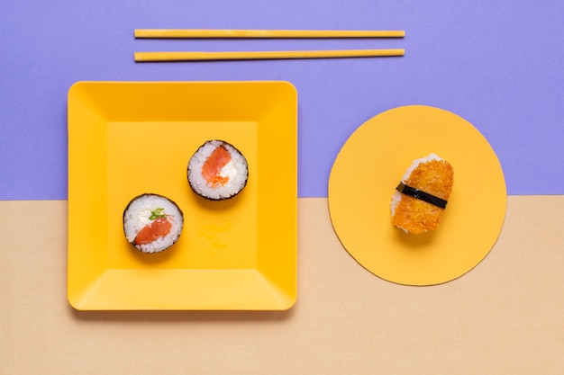 Plates with sushi on table