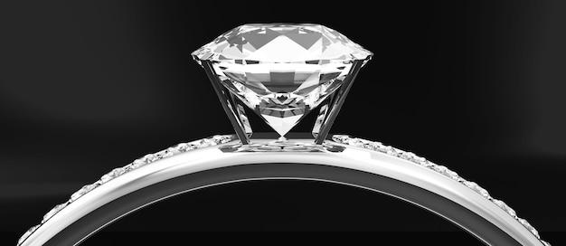 黒のスタジオの背景にダイヤモンドとプラチナの結婚指輪
