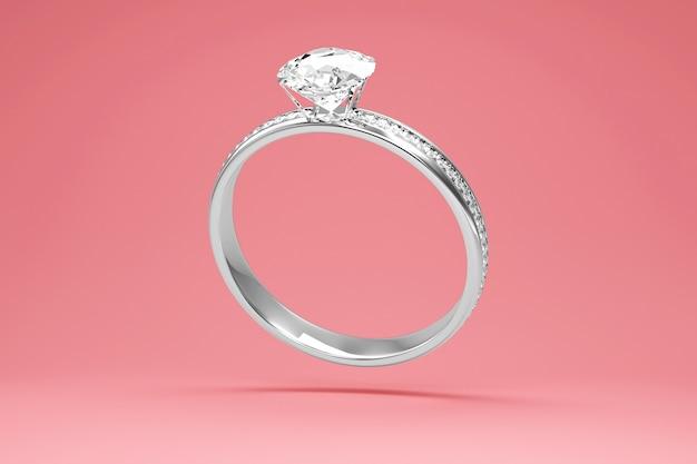 スタジオの背景にダイヤモンドとプラチナの結婚指輪