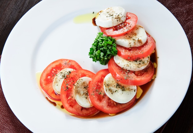 Platter with mozzarella cheese and tomatoes