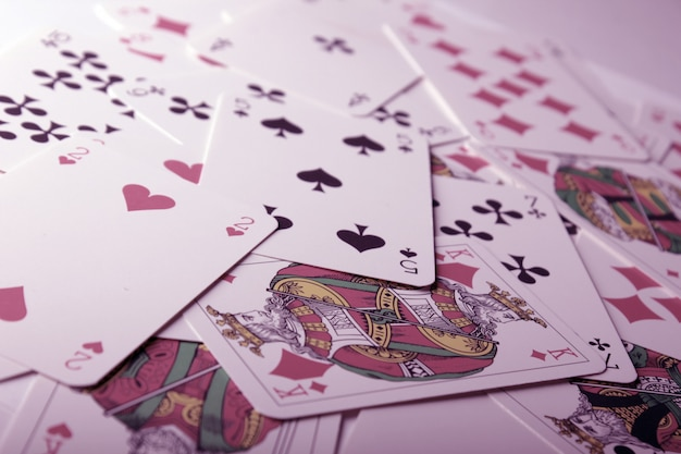 Play cards scattered on the table.