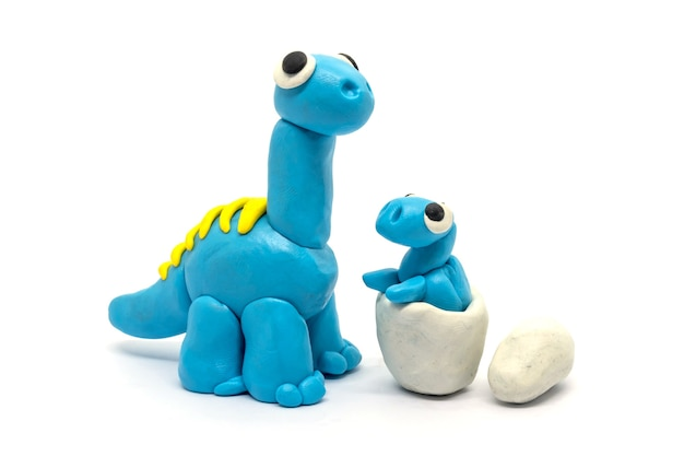 Play dough brachiosaurus and egg on white isolated